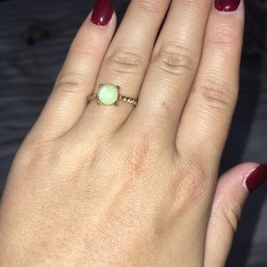 Gold ring with light green gem